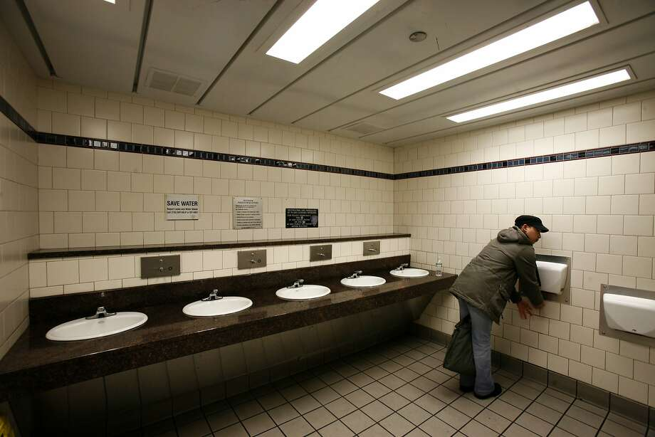 FILE -- A hand dryer in use in a bathroom in New York, Jan. 12, 2008. Whether hand dryers spread pathogens is a matter of dispute among scientists. (Gabriele Stabile/The New York Times) Photo: GABRIELE STABILE, NYT