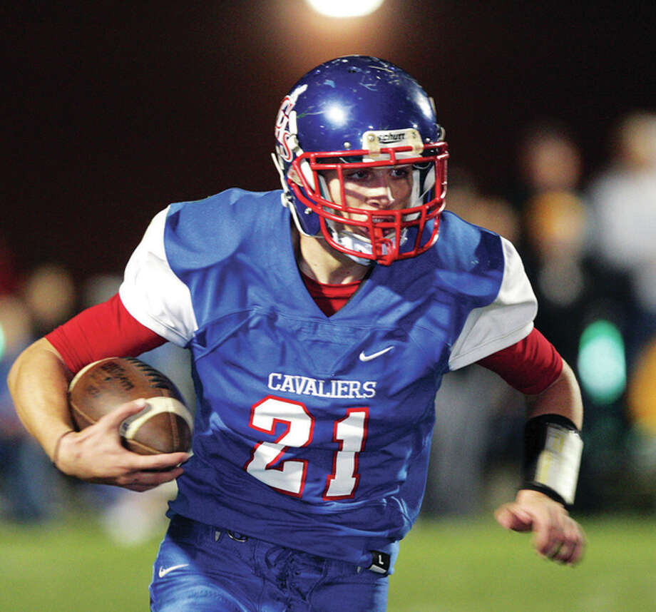 Carlinville's Jacob Dixon ran for 248 yards and threw a game-winning touchdown pass to Brady Jamieson in Saturday's 42-35 Class 3A second-round home playoff win over Williamsville. Photo: James B. Ritter File Photo | For The Telegraph