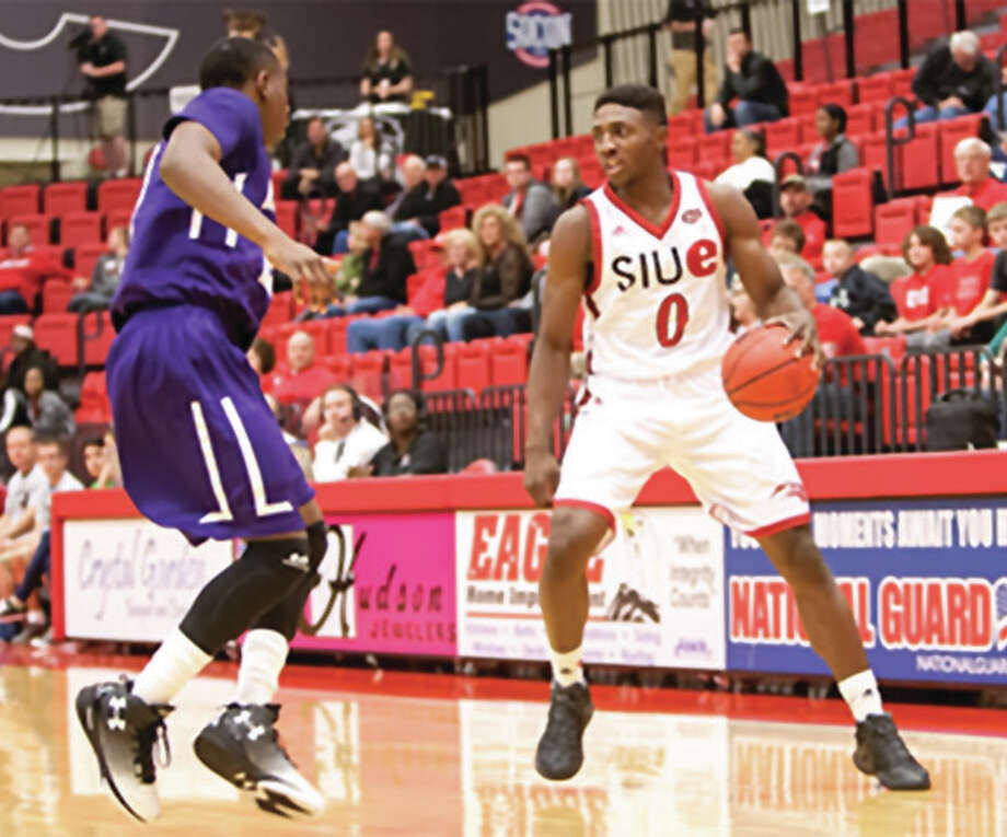 SIUE's Carlos Anderson (right), a sophomore from Alton, handles the ball during his 17 points, 10 rebounds night against McKendree on Saturday in a men's college basketball exhibition game at Vadalabene Center in Edwardsville. Photo: SIUE Athletics