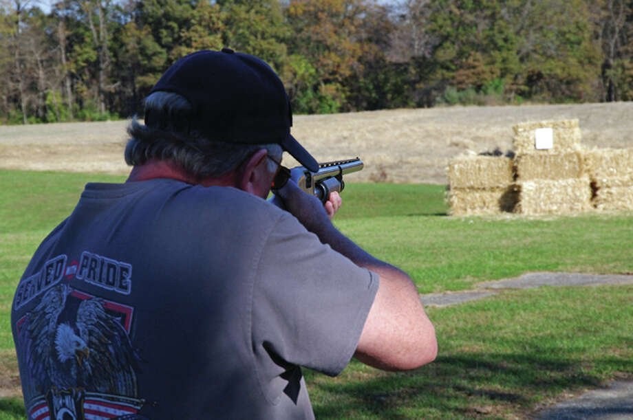 Designated shooter Dave Fullagar shoots at a paper target during Sunday's turkey shoot fundraiser at the Alton Post 1308 Farm near Brighton. Photo: David Blanchette|For The Telegraph