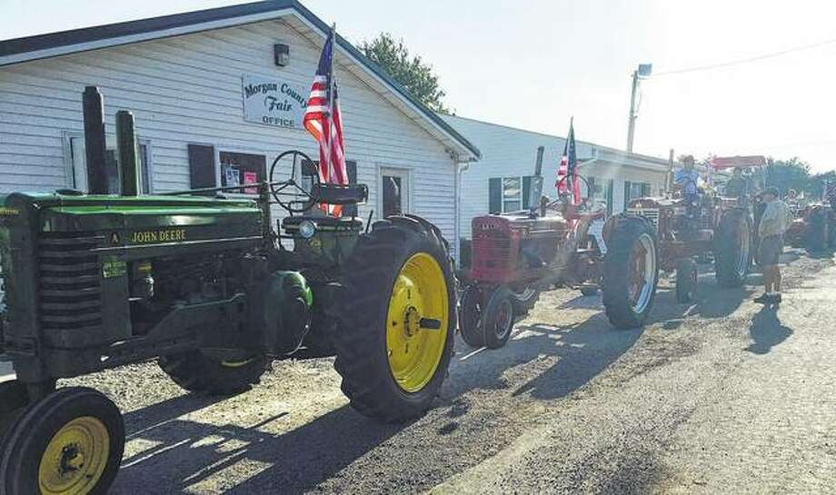 Tractors line up for the opening parade at the Morgan County Fair in Jacksonville. Photo: Joy Harris | Reader Photo