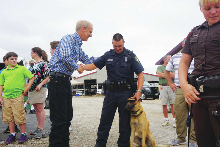 Rauner signed the bill on First Responders Day at this year's state fair during a ceremony at the Illinois State Police (ISP) tent. For The Telegraph