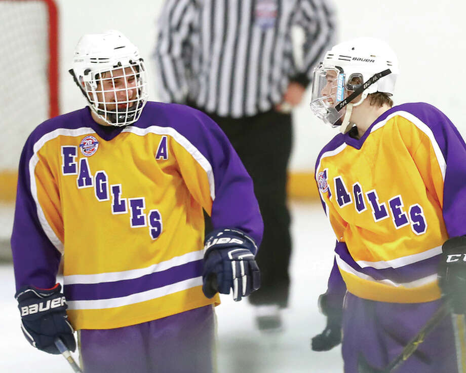 Bethalto's Anthony Russo, right, scored three goals and teammate Jayden Kahl, right added two in their team's 11-3 MVCHA win over Highland Monday night at the East Alton Ice Arena. They are pictured after a goal in last week's season-opening win over East Alton-Wood River. Photo: Billy Hurst | For The Telegraph