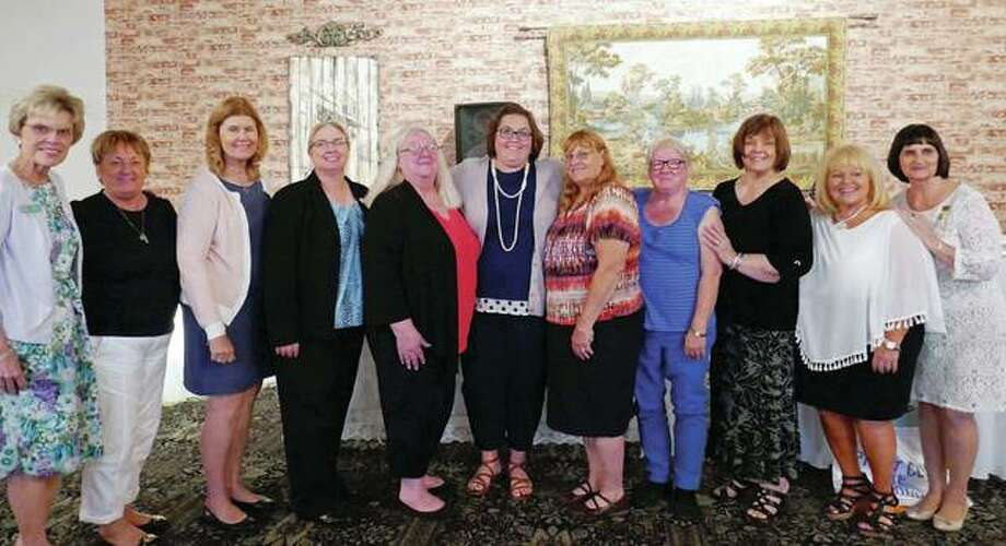 Pilot Club of Jacksonville installed its 2017-18 executive board during its June 28 meeting at Hamilton's. New board members include Vickie Austin (from left), treasurer; Karla Stice, assistant treasurer; Sue Morrow, secretary; Tina Young, president-elect; Patty Osborne, past president; Shelle Allen, president; and Clair Moos, Martha Hauck and Linda Meece, directors. Diana McCutcheon-Bushnell and Karla Henderson installed the new board members. Not pictured are Nancy Holt, corresponding secretary; and Barb Austin and Carol Cody, directors. Photo: Photo Provided