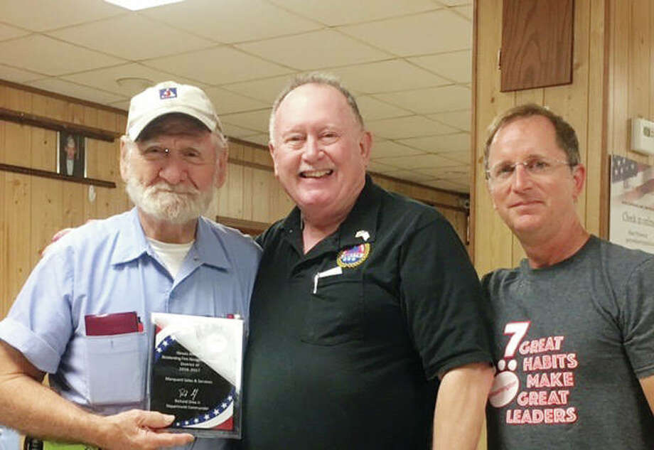Ed Marquard (left) of Marquard Sales and Service recently was honored for his longtime dedication and service to AMVETS. The award was presented during the Jacksonville Area Landlord Association's July meeting by Jim Duncan of Jacksonville AMVETS and Tim Sanders, president of the Jacksonville Area Landlord Association. Photo: Photo Provided