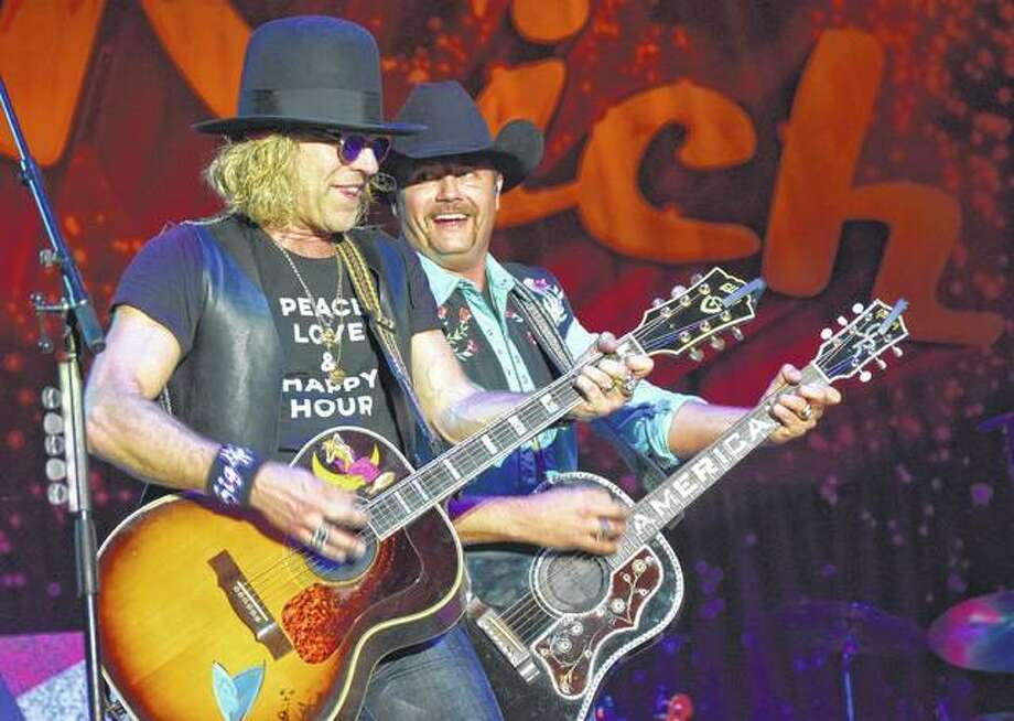 Big Kenny (left) and John Rich of Big and Rich perform Saturday at the Morgan County Fair. More photos of the concert and of the opening act, Drew Baldridge, are available at myjournalcourier.com — here and here. Photo: Samantha McDaniel-Ogletree | Journal-Courier