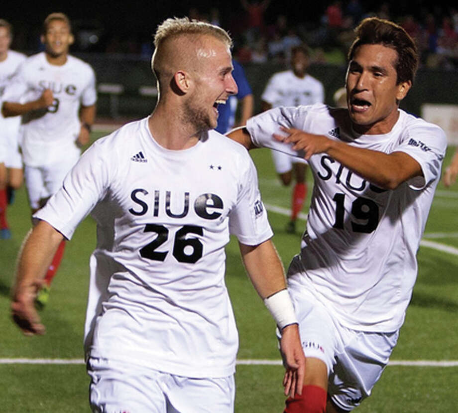 SIUE's Greg Solawa (26) and teammate Ivan Gutierrez celebrate a Cougars goal during action earlier this season. SIUE will face Evansville Friday in a semifinal of the Missouri Valley conference Men's Soccer Tournament Friday in Springfield, Illinois.