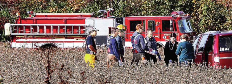 Fosterburg firefighters came to the assistance of a driver who ran off into a field along Illinois 255 in this file photo taken in late October. Fosterburg, Godfrey and Cottage Hills all passed tax referendums to help fund their fire protection districts.