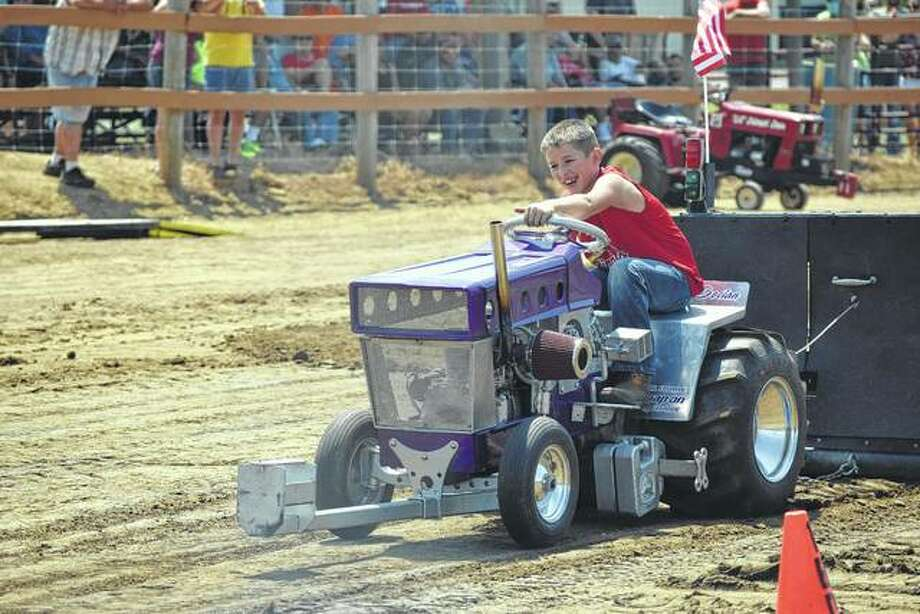 Declan Lahey, 10, of Murrayville pulls 18.639 feet in his event to take third place Sunday afternoon in the Morgan County Fair's garden tractor pull competition. Photo: Audrey Clayton | Journal Courier