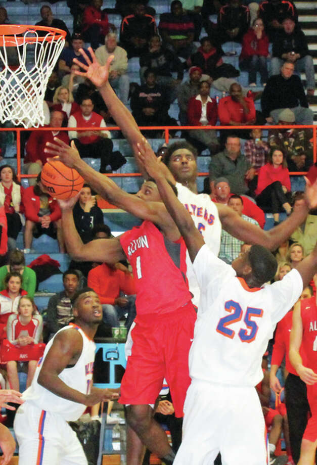 Jeremiah Tilmon of East St. Louis (back) defends against Alton's Carlos Anderson (1 )in a 2015 game at Alton High. The 6-foot-10 Jeremiah Tilmon, an Illinois recruit, passed on Wednesday's signing date. Photo: Telegraph File Photo