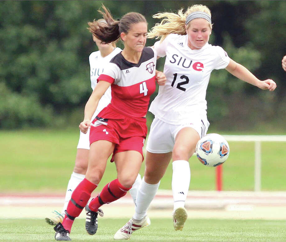 SIUE's Lindsey Fencel (12) battles for the ball with Gina Fabbro of Austin Peay earlier this season. Fencel, a graduate of Civic Memorial High, scored the Cougars' only goal in a 1-0 victory over Eastern Kentucky Sunday in the Ohio Valley Conference Tournament championship game. SIUE will play at No. 2 seed Notre Dame Friday in the NCAA Tournament. Photo: SIUE Athletics