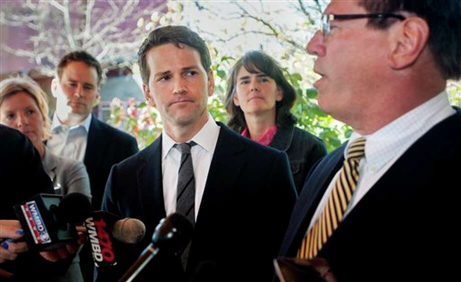 Former U.S. Rep. Aaron Schock, center, and members of his family listen as attorney Jeff Lang, right, speaks during a press conference Thursday, outside Peoria Heights Village Hall in Peoria Heights, Ill. Schocks defense team said Thursday that the former congressman, who resigned amid scrutiny of lavish spending, expects to be indicted by a federal grand jury.