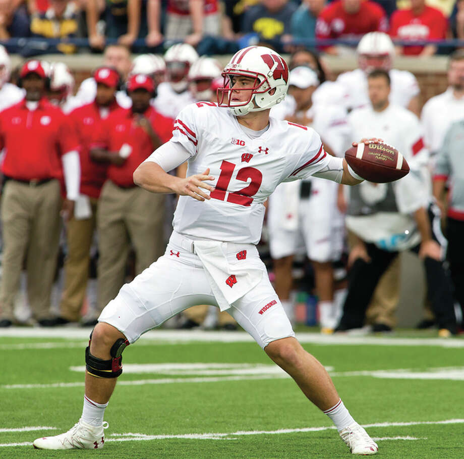 Wisconsin quarterback Alex Hornibrook throws a pass in the second quarter earlier this season against Michigan. He and his teammates will play host to Illinois in a Big Ten game Saturday in Madison, Wisconsin. Photo: AP