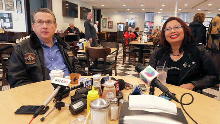 Sen Mark Kirk, R-Ill., left, and Sen.-elect Tammy Duckworth, D-Ill., take reporter's questions at a local deli Friday, Nov. 11, 2016, in Chicago. It was their first meeting since she defeated the incumbent Kirk in Tuesday's election.