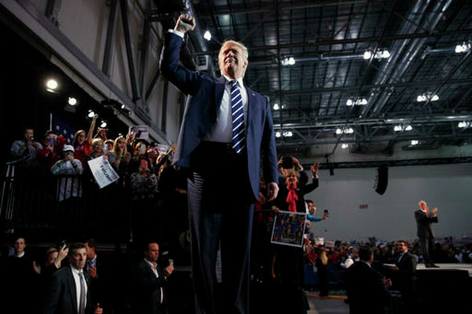 In this Tuesday, Nov. 8, 2016, file photo, Republican presidential candidate Donald Trump pumps his fist as he arrives to speak at a campaign rally in Grand Rapids, Michigan. President-elect Donald Trump inherits a much sturdier economy than the one Barack Obama took into his second term four years ago. Yet economic growth remains stubbornly sluggish and is expected to remain so. (AP Photo/Evan Vucci, File) Photo: (AP Photo|Evan Vucci, File)
