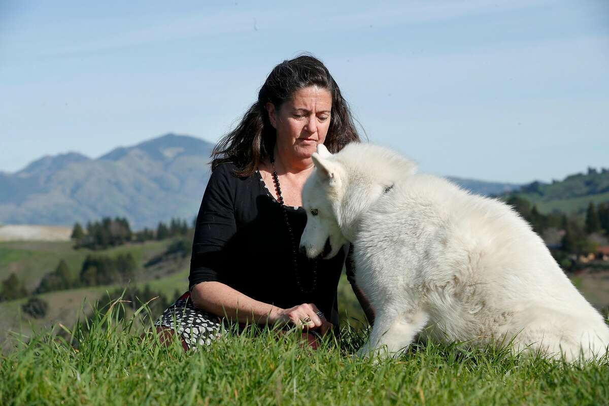 Lynda Deschambault, with her dog Kodiak visit the Mulholland Open Space that she helped to preserve back in the early 2000's, in Moraga, Calif., seen on Friday Feb. 9, 2018. Deschambault, an environmental scientist who worked for 20 years for the EPA, overseeing a Superfund site, when the new administration decided to go