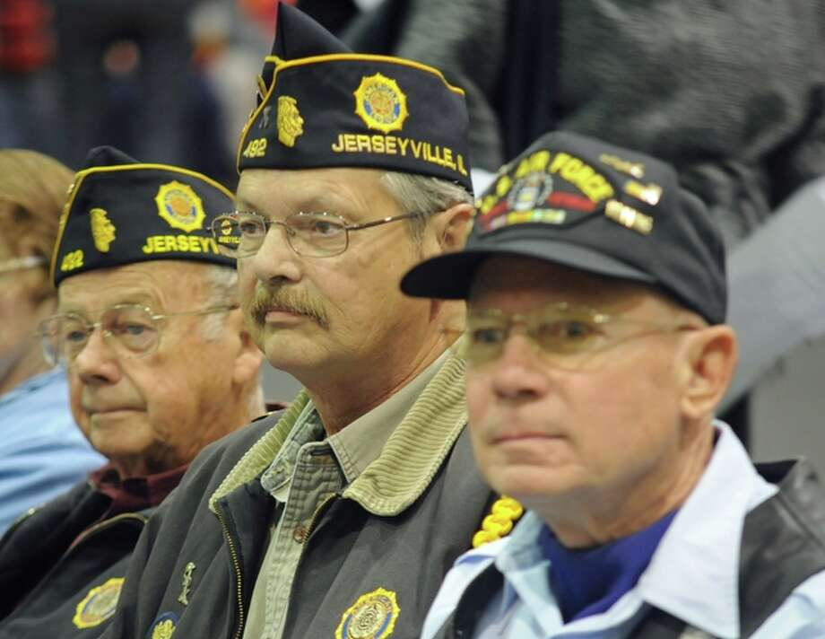 Veterans Wilbert Sackman, Vernon Timcke and Edward Downey listen during Thursday's Veterans Day Assembly at Jersey Community High School.