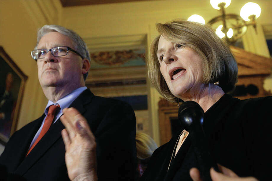Illinois Senate Minority Leader Christine Radogno, R-Lemont, right, and Illinois House Minority Leader Jim Durkin, R-Western Springs, left, speak to reporters after meeting with Illinois Gov. Bruce Rauner at the Illinois State Capitol Monday, Nov. 14, in Springfield, Illinois. Rauner and the Republicans were able to eliminate the Democrats' supermajority in the House on Nov. 8 after spending millions in the election campaign. Photo: (AP Photo/Seth Perlman)