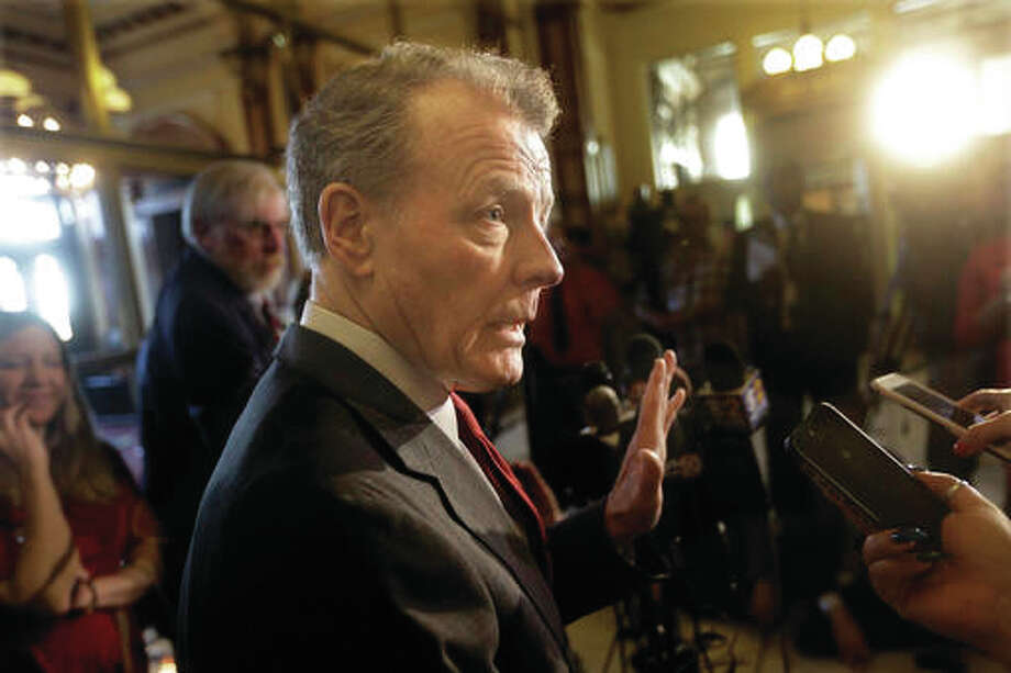 Illinois Speaker of the House Michael Madigan, D-Chicago, talks to reporters outside Illinois Gov. Bruce Rauner's office at the Illinois State Capitol during veto session Tuesday, Nov. 15, in Springfield, Illinois.