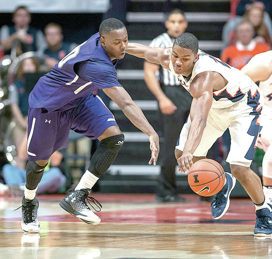 McKendree's Michael Jackson (20) and Malcolm Hill of Illinois go after a loose ball during the first half of Tuesday night's game in Champaign. Photo: AP