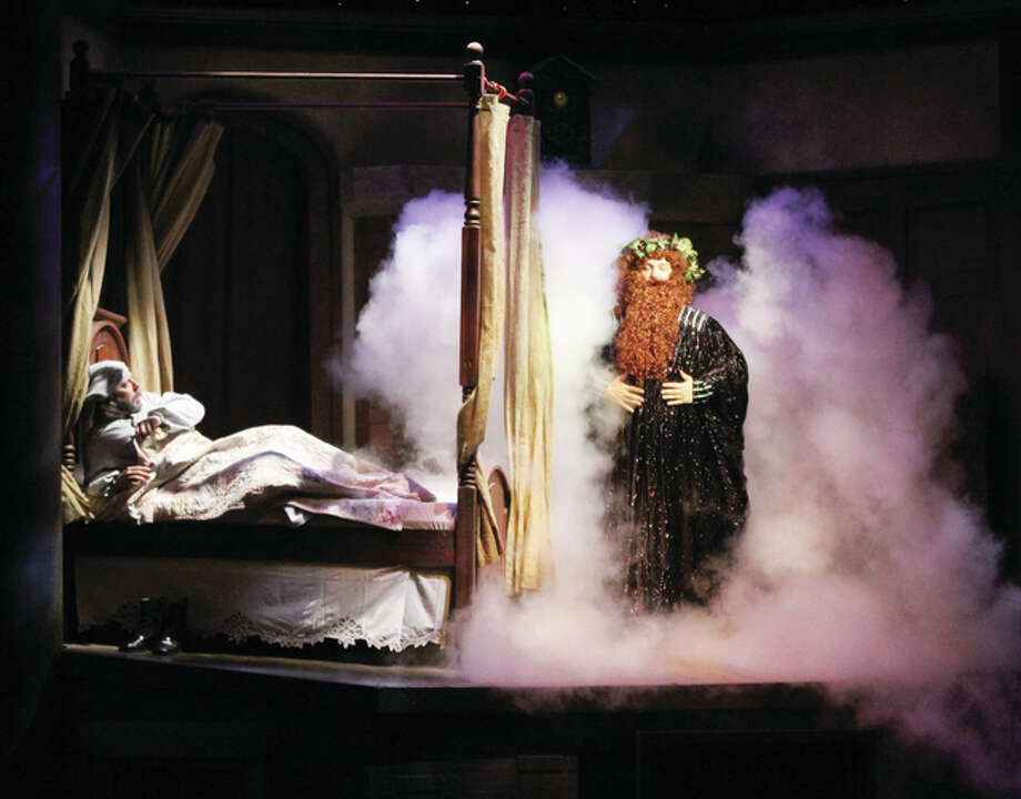 "Ebenezer Scrooge recoils as the Ghost of Christmas Past comes out of the fireplace during ""A Dickens' Christmas Carol,"" a part of Silver Dollar City's An Old Time Christmas, which runs now through Dec. 30. Photo: Scott Cousins/The Telegraph"