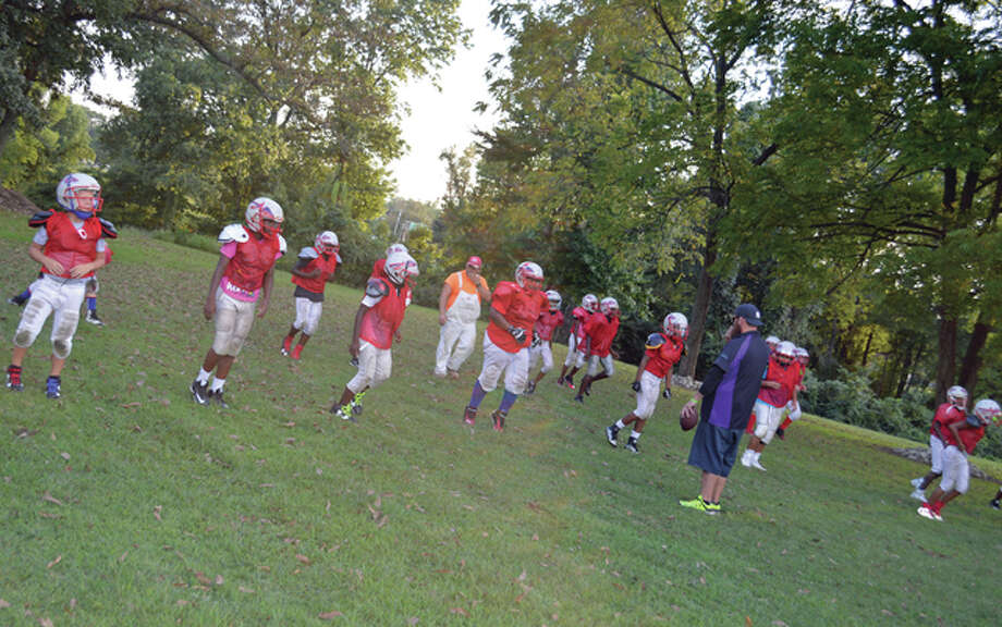 The Alton Renegades 11-and-under team, at practice led by assistant coach Matt Garner.