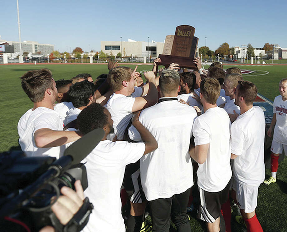 Members of the SIUE men's soccer team celebrate with the Missouri Valley Conference Tournament championship trophy following their 1-0 win over host Missouri State University Sunday in Springfield, Mo. The Cougars will face Michigan State at noon Thursday in a first-round game of the NCAA Division I National Tournament.