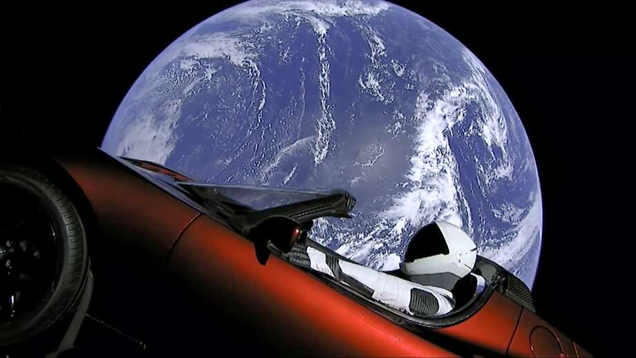 """Elon Musk's red Tesla sports car, with """"Starman"""" in the driver's seat, was was launched into space during the first test flight of the Falcon Heavy rocket on Tuesday. Photo: Associated Press"""