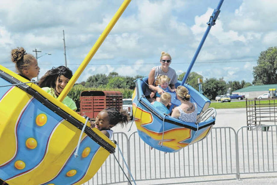 South Jacksonville Celebration 2016 attendees spin around on a carnival ride in July 2016 in the south parking lot of First Christian Church. This year's Celebration will be Friday evening and Saturday at the church. Photo: Greg Olson | Journal-Courier