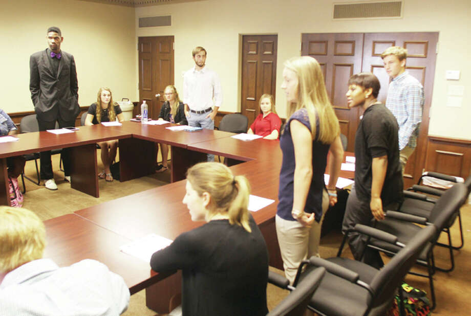 Students stand during an exercise in networking as part of the Riverbend CEO program in August. The program, which includes Marquette and Alton high school students, is expanding next year to include Roxana and East Alton-Wood River high schools.