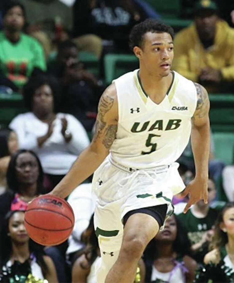 After sitting out last season following his transfer from SIUC, former Marquette Catholic standout Deion Lavender is back on the court with the Alabama-Birmingham Blazers. The 6-foot-4 redshirt sophomore from Alton has taken over at point guard for the Blazers, who lost starter Nick Norton to a season-ending knee injury in the team's opener against Arkansas-Pine Bluff. Through a 1-1 start, Lavender leads UAB in minutes played and assists while averaging 2.5 points and 4.5 rebounds per game. The Blazers play Thursday night at home against Troy before traveling to Kansas City to play Kansas in a nationally televised game (ESPN2) on Monday night. Photo: UAB Athletics