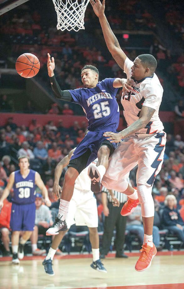 McKendree's Justin Blanks (25) is fouled by Illinois center Mike Thorne Jr. (33) during Tuesday night's game in Champaign. Photo: AP