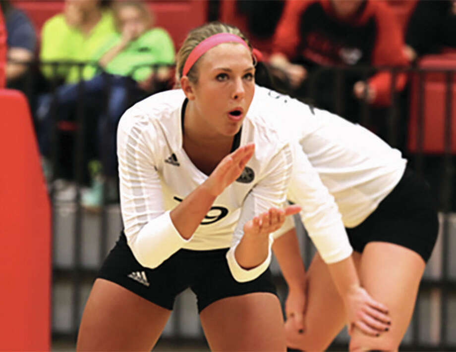 SIUE setter Mallory Mangun, shown during a match earlier this season in Edwardsville, helped the Cougars sweep Morehead State in the OVC Tourney on Thursday one day after earning All-OVC honors. Photo: SIUE Athletics