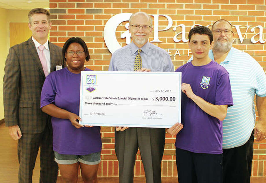 Kevin Eckhoff (center), communications coordinator and race director for the Passavant-Gatorade 5K/10K, presents a check for $3,000 to Jacksonville Saints Special Olympics team members Crystal Jackson (second from left) and Jesse Mattern (second from right). The check represents proceeds from this year's 25th annual Passavant-Gatorade 5K and 10K. Jackson and Mattern both participated in the May 27 event. Also on hand for the check presentation were Harry Schmidt (left), Passavant president and chief executive officer, and Richard Larkin, community living services director for Pathway Services Unlimited. The Jacksonville Saints Special Olympics program provides competition in several sports to more than 100 Special Olympics athletes from Jacksonville and the surrounding area. Photo: Photo Provided