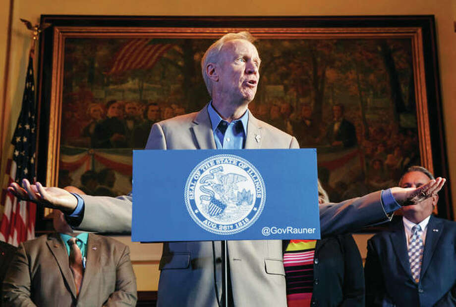 Gov. Bruce Rauner speaks Wednesday during a news conference on the first day of a special session on education funding at the state Capitol in Springfield. A proposal to change how Illinois distributes school money remains locked up in a fight between the Democrat-majority Legislature and Republican Rauner. Photo: Justin Fowler | The State Journal-Register | AP