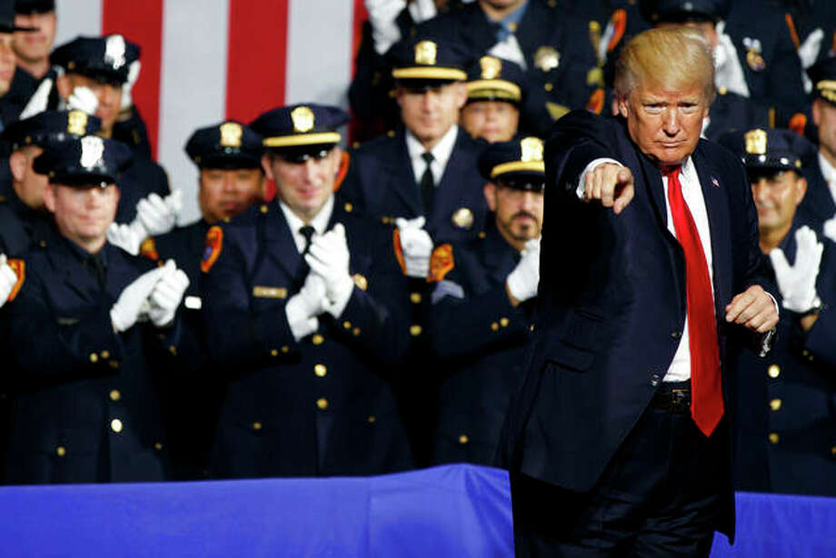President Donald Trump points to the crowd after speaking to law enforcement officials Friday in Brentwood, New York. Photo: Evan Vucci | AP