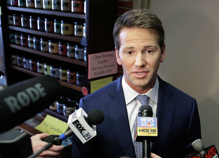 In this Feb. 6, 2015, file photo, former U.S. Rep. Aaron Schock, R-Ill. speaks to reporters in Peoria, Illinois A federal indictment charges Schock with allegedly using government and campaign money to subsidize a lavish lifestyle, included an allegation that he also pocketed thousands of constituent dollars. Prosecutors say Schock hosted expensive Washington meet-and-greets, charged a fee and secretly kept some of the cash. State political observers say the alleged scheme stands out, even with Illinois' long-established reputation for corruption. Photo: (AP Photo/Seth Perlman, File)