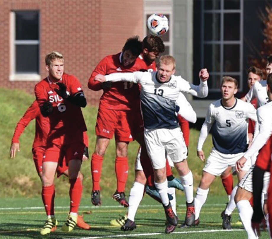 SIUE's Jason Hackett (middle, left) rises above Butler's Eric Leonard for a header during an NCAA Tournament second round men's soccer match at Indianapolis on Sunday. The Cougars won in PKs and will play at Wake Forest next Sunday. Photo: Butler Athletics