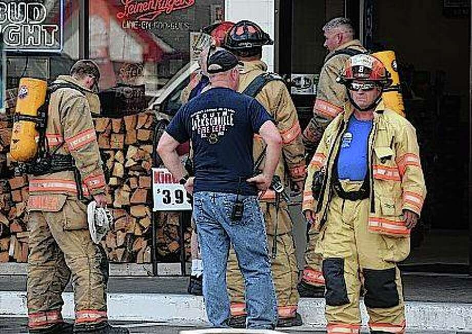 Firefighters work on venting carbon dioxide from a store after it was pumped into the building in error. Photo: Nick Draper | Journal-Courier