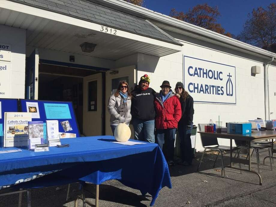 Catholic Charities, directed by Denise Brown, far left, hosted an e-cycling drive led by volunteers this weekend in collaboration with CJD E-cycling, which gave a percentage of the drive's proceeds to the nonprofit organization that assists thousands of people every year with programs such as a food pantry, counseling services, homeless prevention and Faith-in-Action that matches volunteers with senior citizens.
