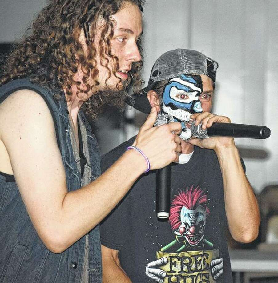 Cody 'Archie' Springer (left) and Joe 'Wicked Sweet' Wigger with the Kutthroat Karnies perform July 21 during the 4 The People Entertainment Hip-Hop Heatwave event.