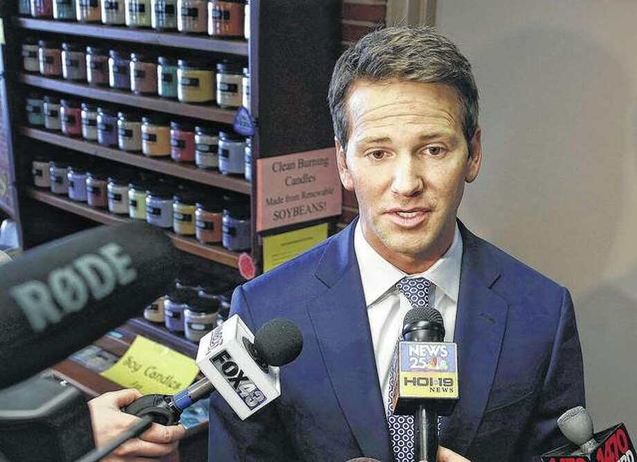 Former U.S. Rep. Aaron Schock speaks to reporters in Peoria in 2015. Lawyers for Schock have accused federal investigators of misconduct in their probe of the once-rising Republican star, and want the charges of fraud against him dismissed.