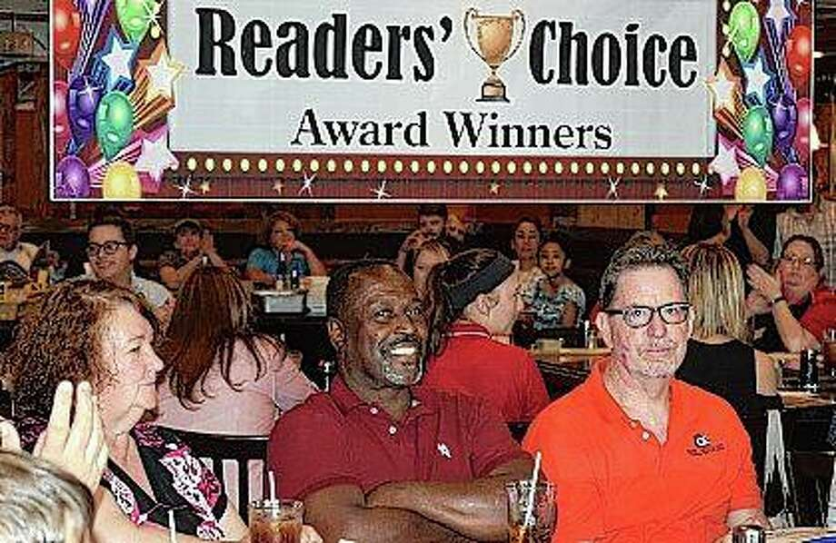 Bret Wade of Wade Photography (right) and Charles Gatlin (center) from Charles Gatlin & Sons — along with many other business owners — listen as awards are given out at the 21st annual Journal-Courier Reader's Choice Awards Thursday at Fujiyama Japanese Steakhouse. The awards, determined by reader polls, show recognition of the many local businesses that call Jacksonville home. Photo: Nick Draper | Journal-Courier