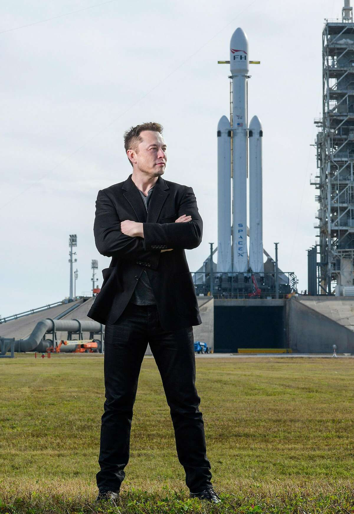 Elon Musk, founder of SpaceX, with the company�s Falcon Heavy rocket at Launch Pad 39A at NASA�s Kennedy Space Center in Cape Canaveral, Fla., Feb. 5, 2018. The rocket�s demonstration flight will carry a Tesla Roadster into space. (Todd Anderson/The New York Times)