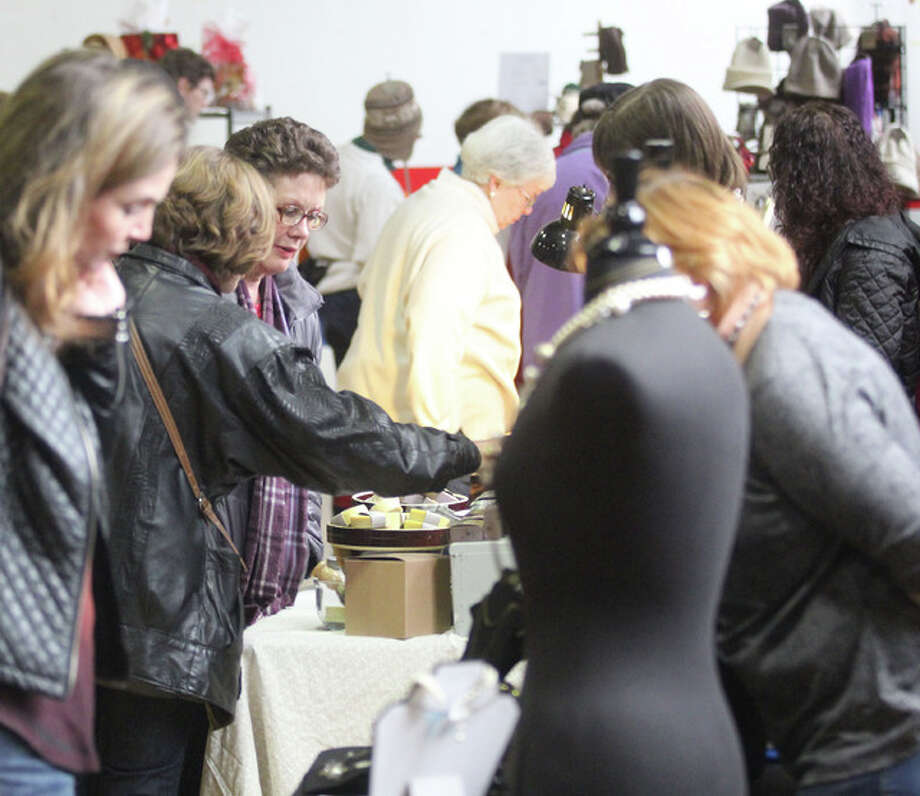 People look over hand-crafted items at last year's annual Green Gift Bazaar. The bazaar is a collaboration between Alton Main Street and the Sierra Club to provide a place for local artisans and businesses to reach out to customers as part of Small Business Saturday.