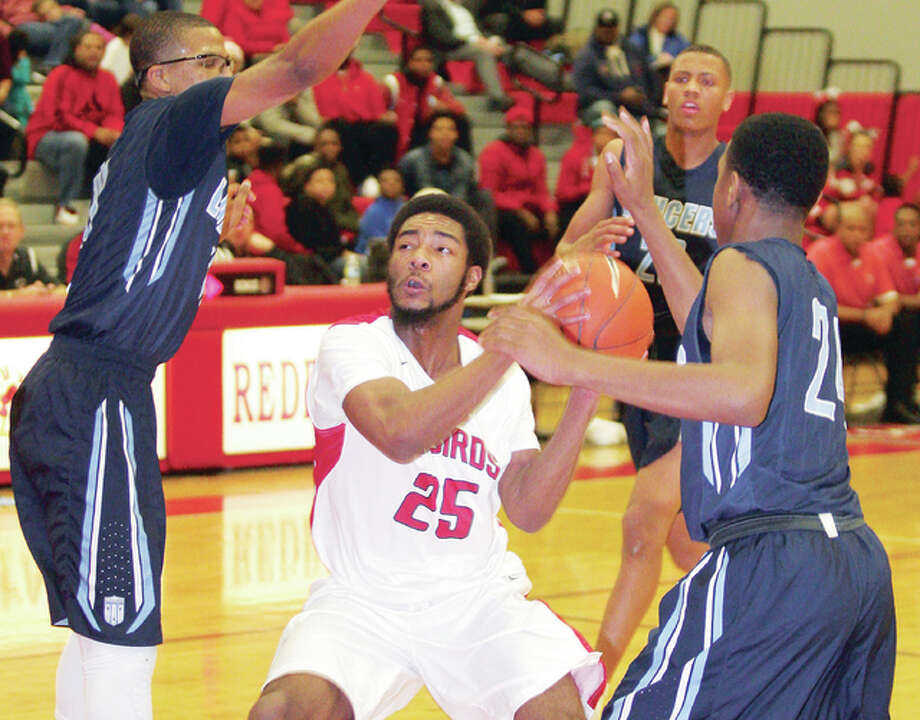 Alton's Maurice Edwards (25) scored 27 points Wednesday night to lead the Redbirds to a 67-54 victory over Riverview Gardens High in a first-round game of the Alton Tip-Off Classic at AHS. Photo: Telegraph File Photo
