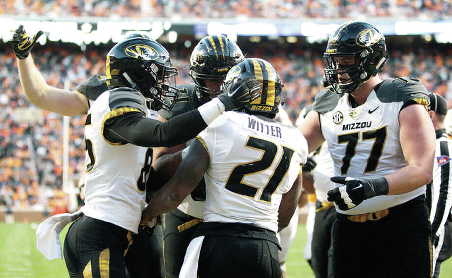 Mizzou running back Ish Witter (21) is congratulated by teammates after scoring a touchdown last Saturday against Tennessee in Knoxville, Tenn. Photo: AP