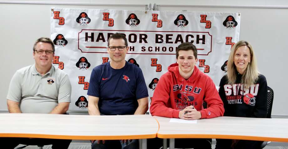 Harbor Beach standout James Schelke signed his letter of intent to play football for Saginaw Valley State University. As a senior, Schelke made the transition from receiver to quarterback and was named the All-Thumb Player of the Year. Schelke will transition back to receiver, where he will join his older brother Josh, who is also a receiver for SVSU. (Paul P. Adams/Huron Daily Tribune)