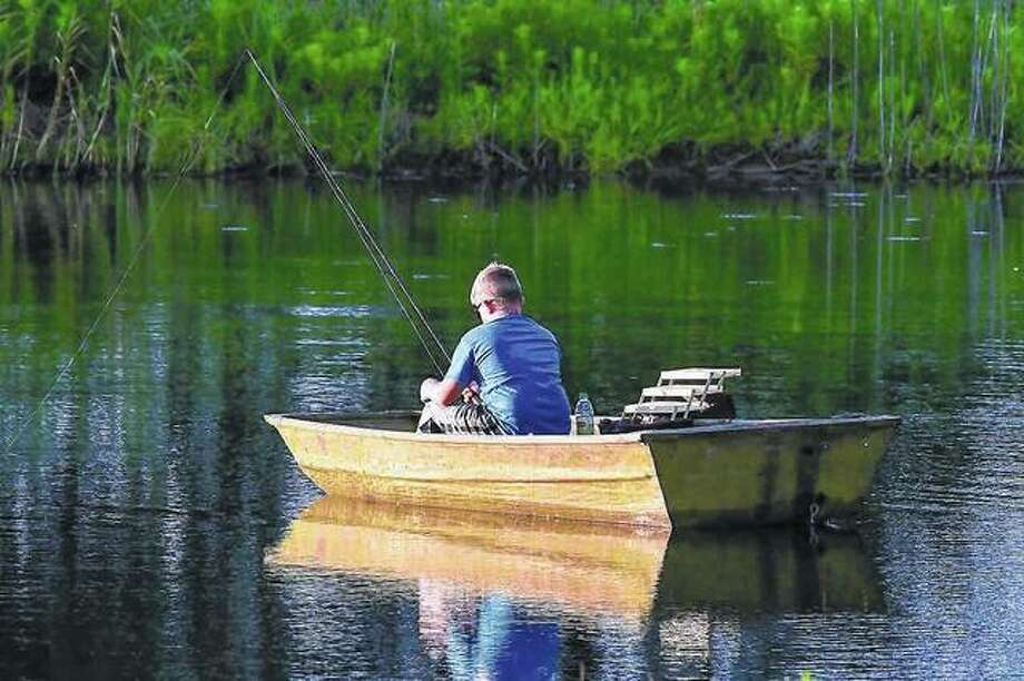 A lone boater spends a quiet summer afternoon on the lake. Photo: Kathy Caruthers | Reader Photo