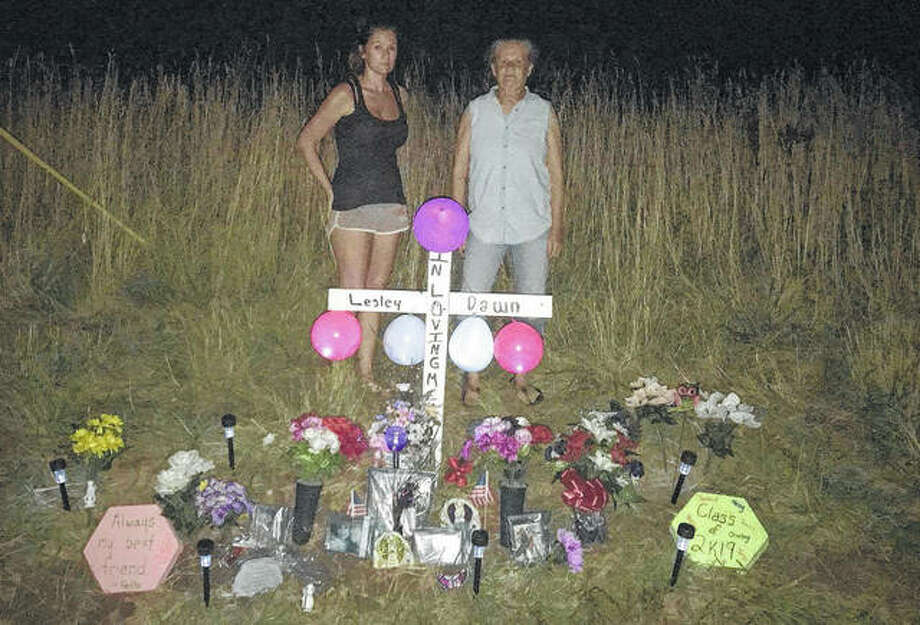 Lesley Bricker's aunt, Kelly Grizzell, and grandmother, Yvonne Sprague, stand at a memorial left at the location of a crash at Country Road 1550E and Roodhouse Blacktop that claimed Lesley's life. Photo: Photo Provided By Family